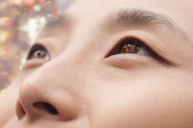 Close up Chinese woman looking up