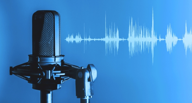 Blue graphic with podcast mic and audio waves