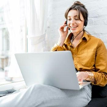 Employee talking on laptop