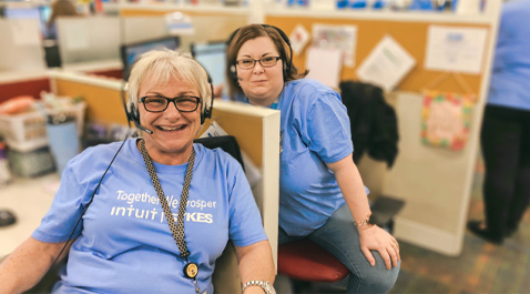 Intuit employees wearing blue tshirts with their headsets