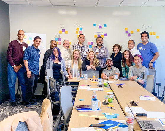 Intuit employees in a conference room
