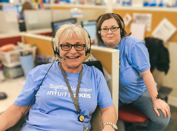 Intuit employees wearing a blue tshirt and wearing their headsets