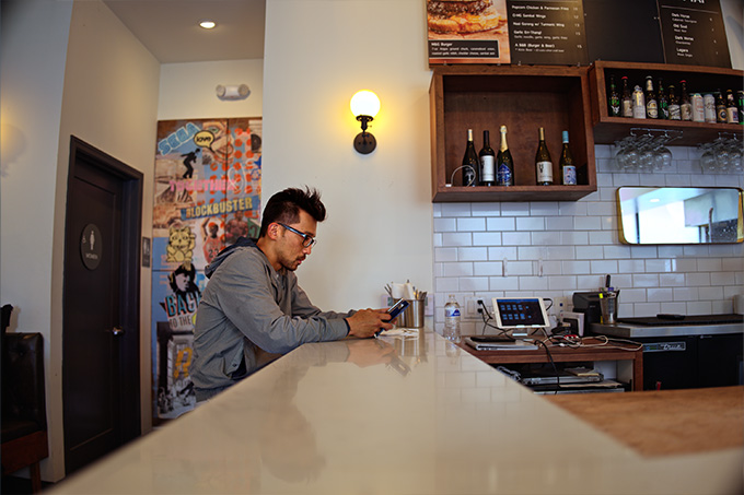 Man sitting at the bar in a restuarant