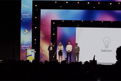 Students on stage at Enactus World Cup 2019