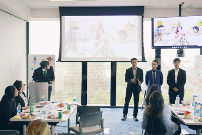 Male students doing a presentation
