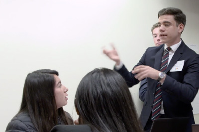 Student speaking in front of other students