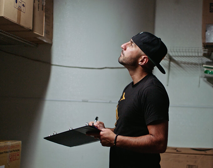 A small business owner checking inventory in the storage room.