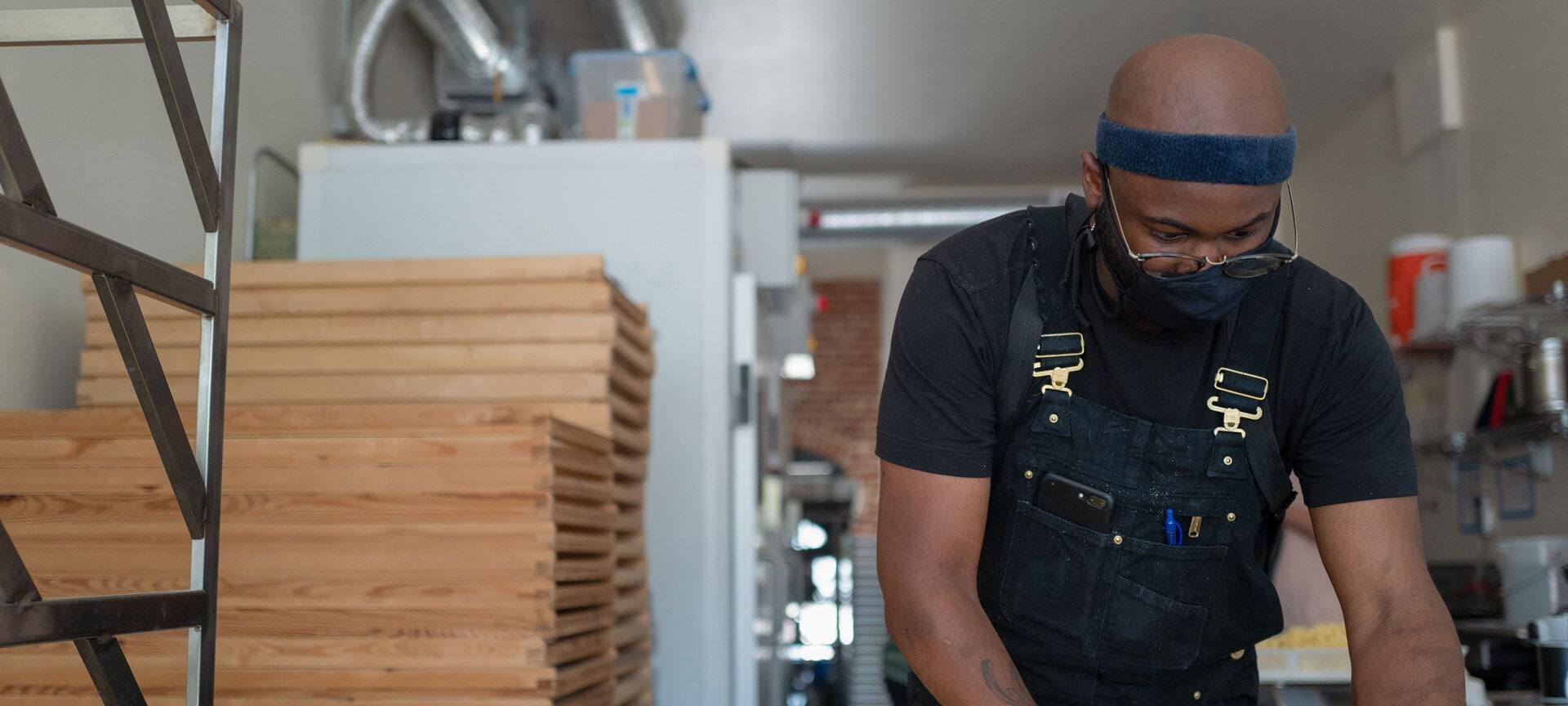 Man doing restaurant kitchen prep work