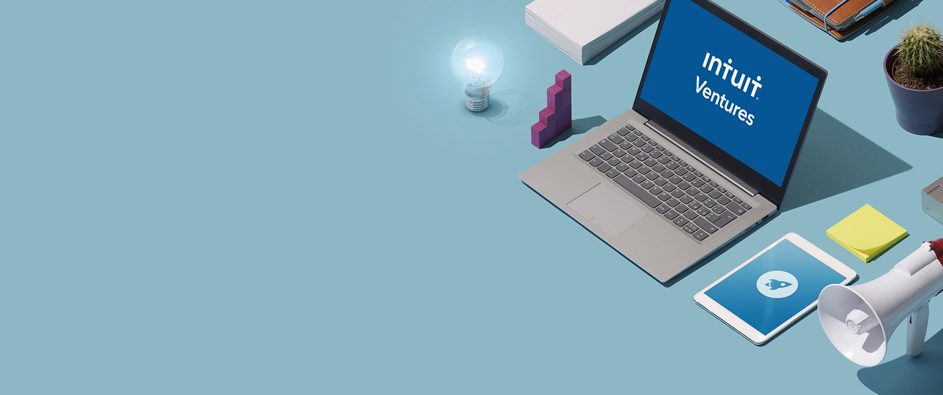 """illustration of a laptop with """"start up"""" on the display, along with other office tools"""